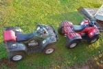two ATVs on grass