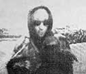 Surveillance photo of ATM suspect in hood and sunglasses