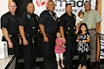 Officer Joshua Dumont, Officer Christopher Kapua-Allison, Officer James Waiamau, Erhard Autrata Jr. with his three children, Mayor Billy Kenoi