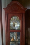 wood and glass grandfather clock