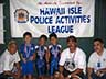 Photo: Menehune Warriors with banner