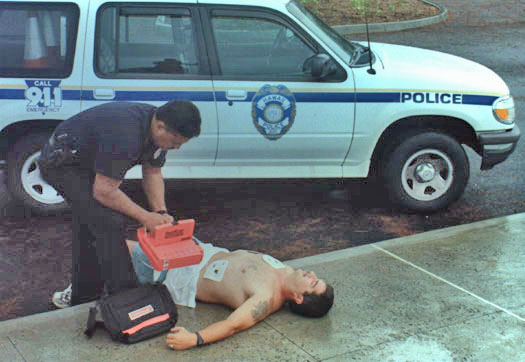 Photo of officer using defibrillator on victim