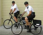 image: two officers on bicycles