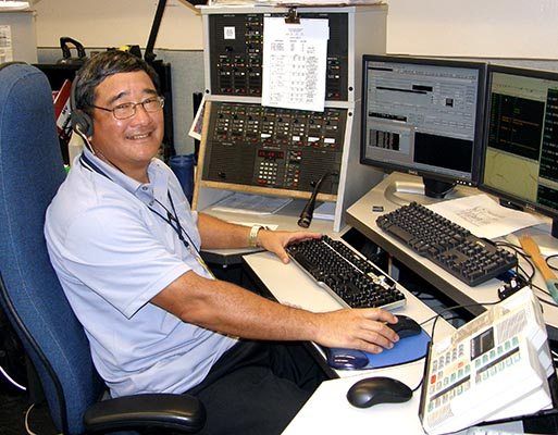 Image of a police dispatcher at his console