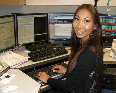 Image of a police dispatcher at her console