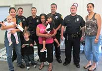 Image: five officers and two families