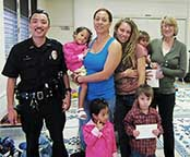 Image: two officers and two families.