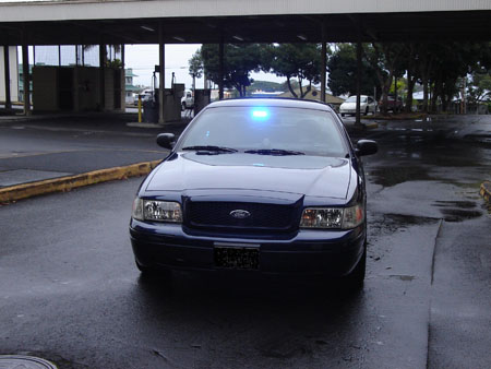 Photo of unmarked police vehicle front view