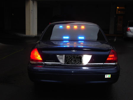 Photo of unmarked police vehicle rear view