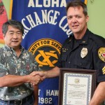 Aloha Exchange President Dale Tokuuke presents an 'Officer of the Month' award to Sergeant Jefferson Grantz